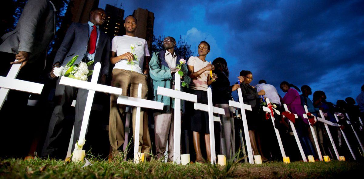 Kenyans light candles next to a white wooden cross for each of the victims of the Garissa attack, in Nairobi, Kenya, April 7, 2015. (AP Photo/Ben Curtis)
