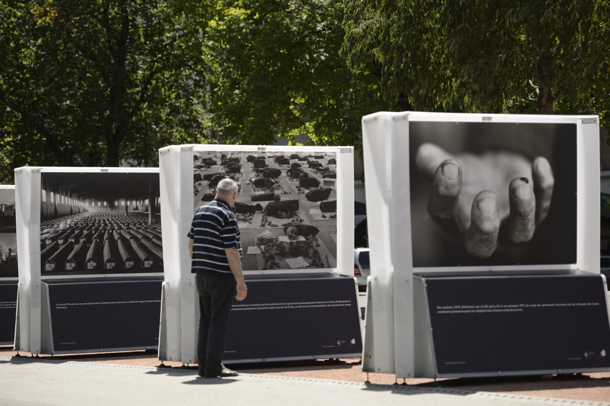 Photographs of Bosnian photographer Tarik Samarah are displayed during the exhibition