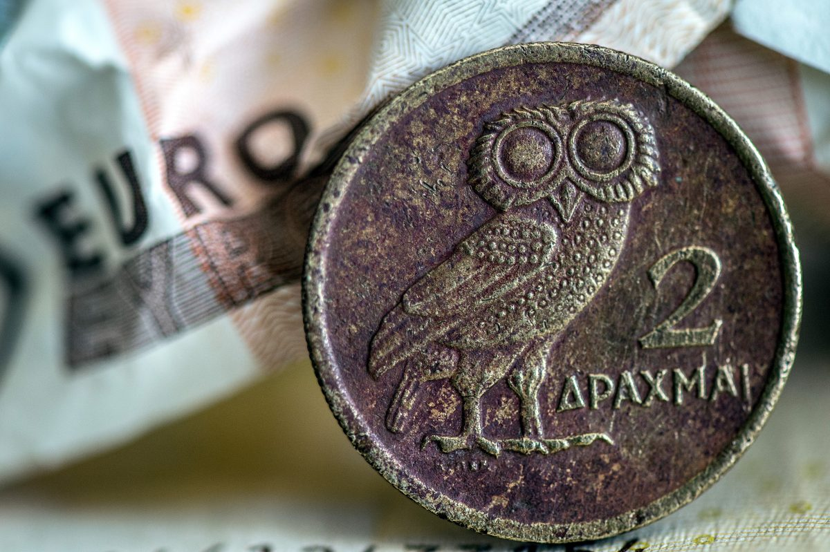 A Greek drachma coin next to a scrunched up Euro banknote, 29 June 2015. Federico Gambarini/picture-alliance/dpa/AP Images