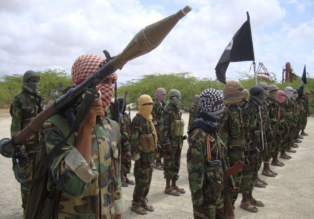 Al-Shabaab fighters display weapons in Mogadishu, Somalia, Oct. 21, 2010, (AP Photo/Farah Abdi Warsameh)