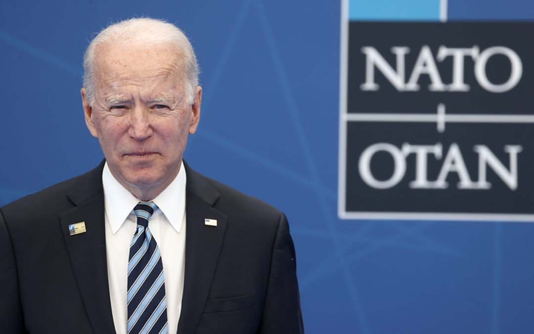 Biden doubles down on Trump's moves to confront a rising China